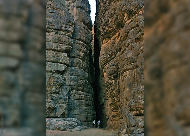 The Ennedi Massif, members of the expedition entering a narrow gorge, Explore Chad
