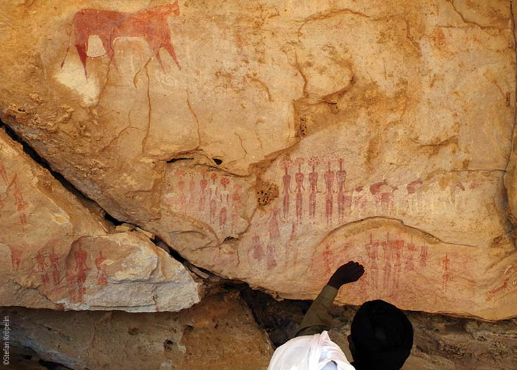 The Ennedi Massif, prehistoric rock art depicting human figures, Explore Chad