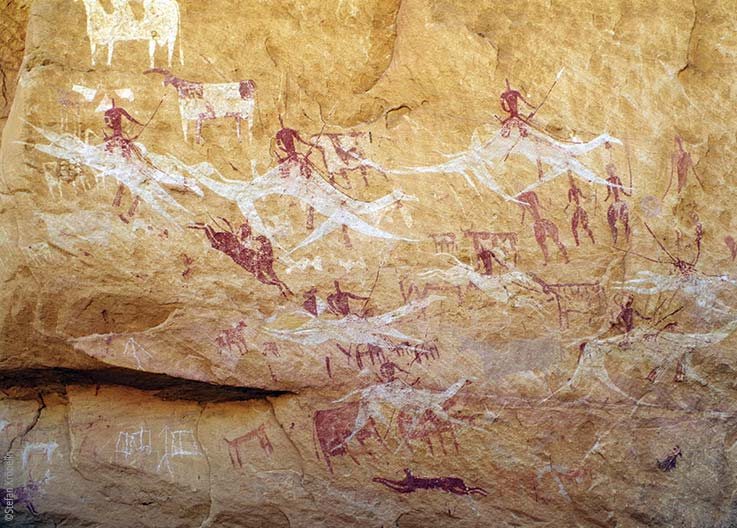 The Ennedi Massif, prehistoric rock art depicting animals and human figures, Explore Chad